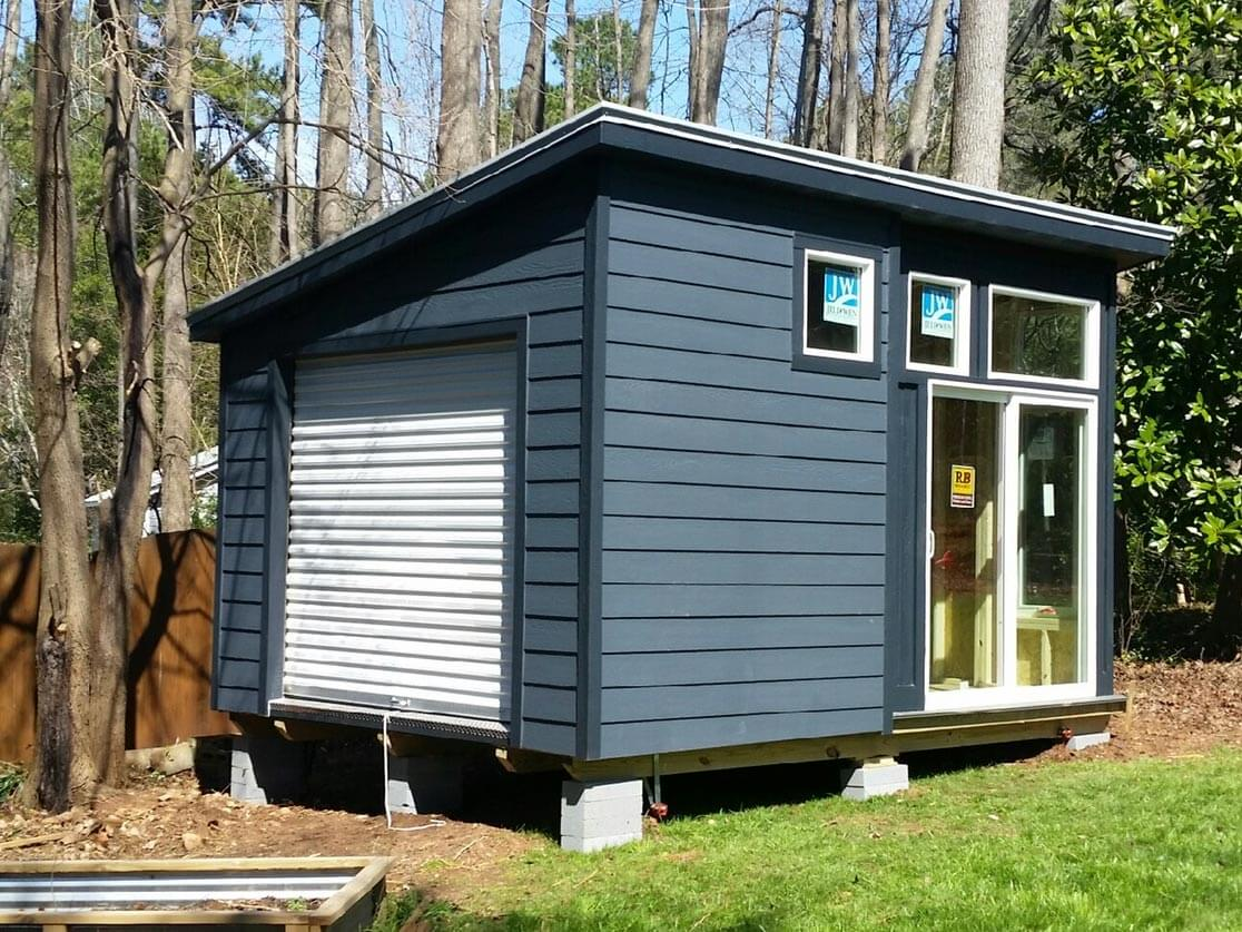 modern series shed with full lite sliding glass doors and