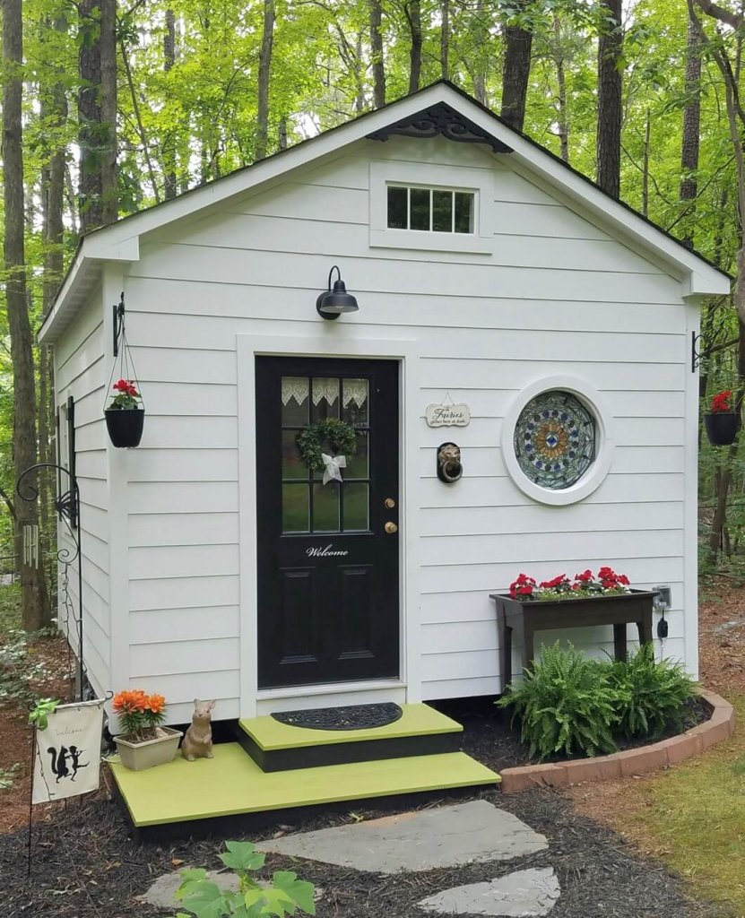 white she shed with black door