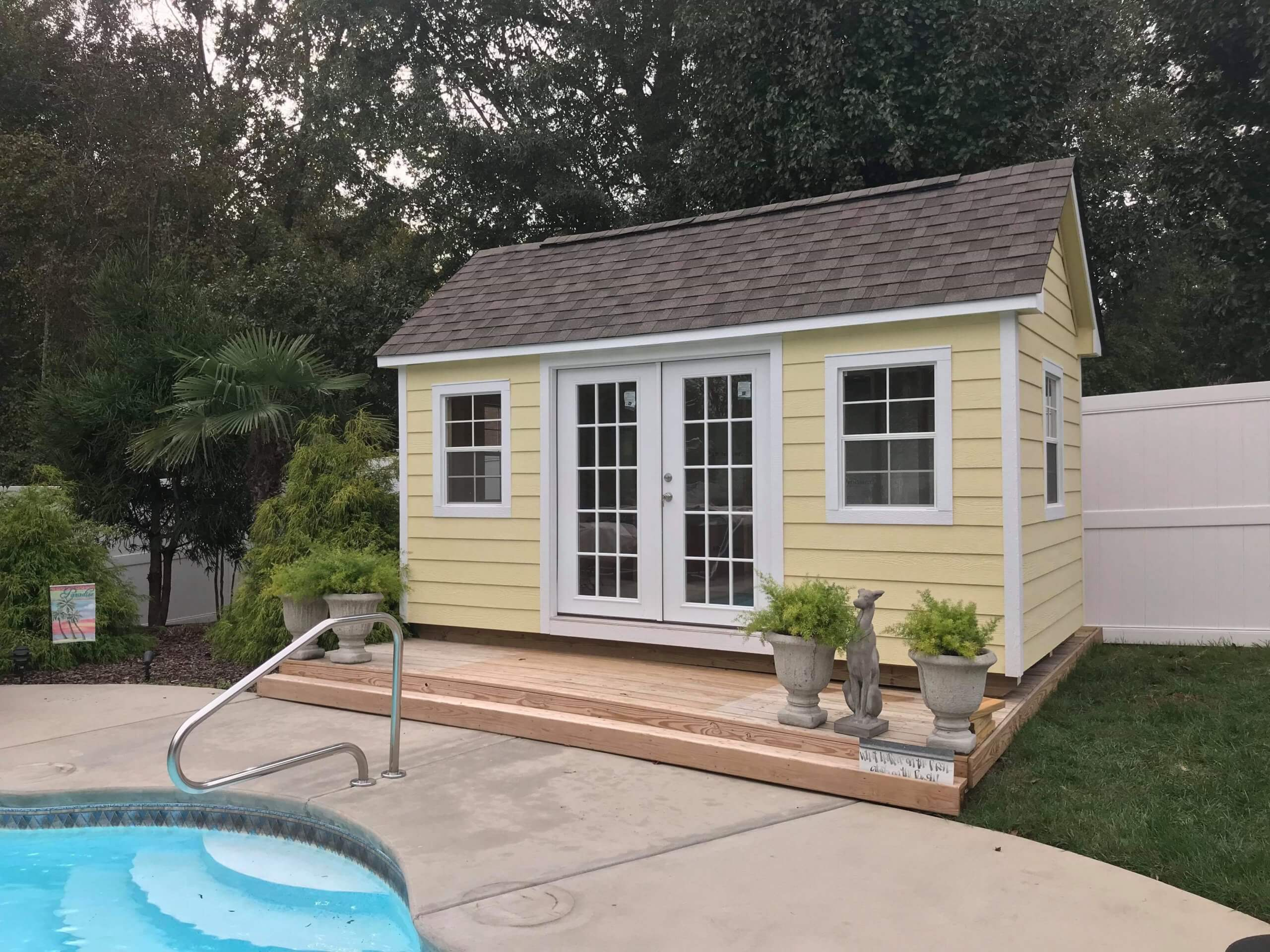 Portable yellow pool changing room from Shed Depot NC