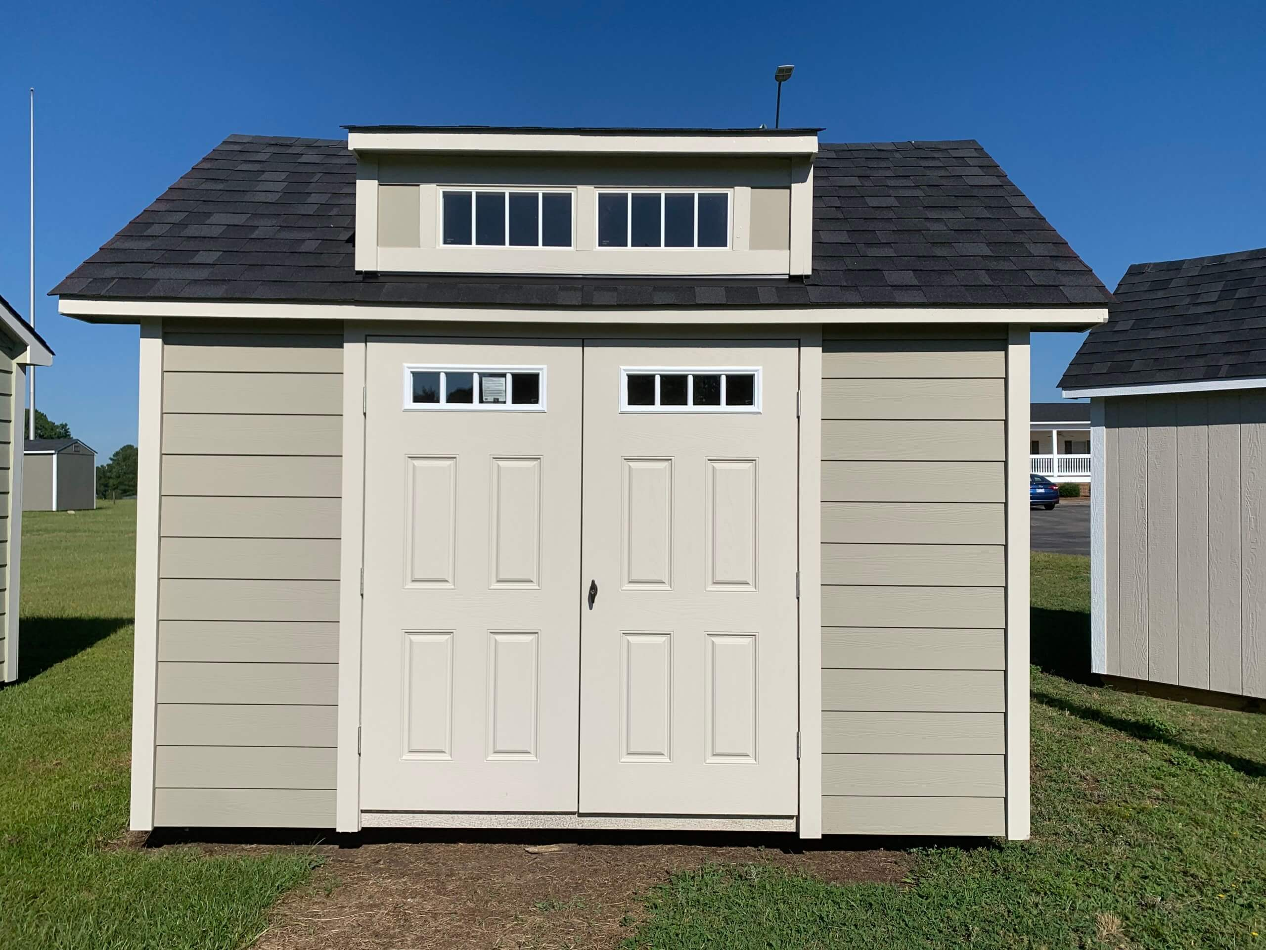 small gray shed with double doors